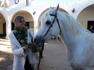 Me with a white stallion at the Royal stables of Princess Alia