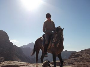 Brenda with her Arabian horse Samiha in the mountains of Petra
